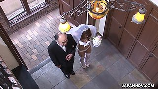 Amateur Asian bride gives a blowjob at the altar