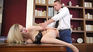 A blonde is penetrated in an erotic scene in the office